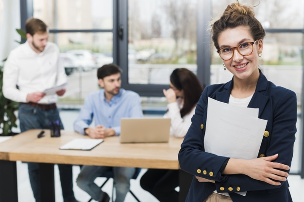 front-view-human-resources-woman-posing-office_23-2148507844
